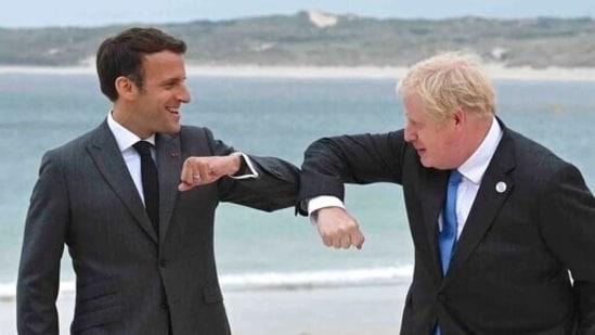 Britain's Prime Minister Boris Johnson greets French President Emmanuel Macron ahead of the G7 leaders meet.(AP)