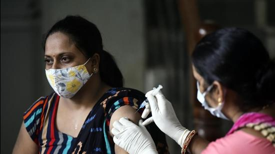 File photo: A woman gets her first Jab of Covid-19 caccination. (Vipin Kumar /HT PHOTO)
