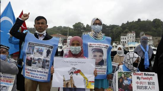 Members of Uighur community living in Turkey stage a protest outside the Chinese consulate in Istanbul. (AP)