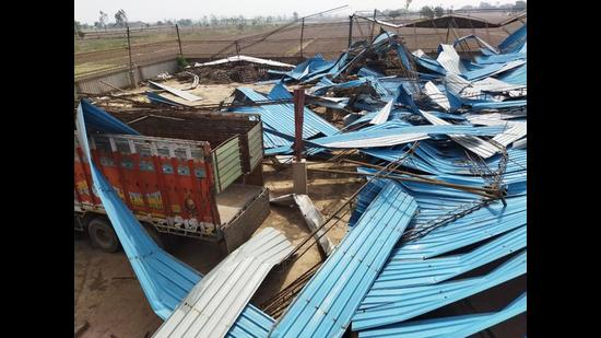The roof of a rice-sheller firm that was blown away in the storm at Daunkalan village in Patiala district on Thursday night. (HT Photo)
