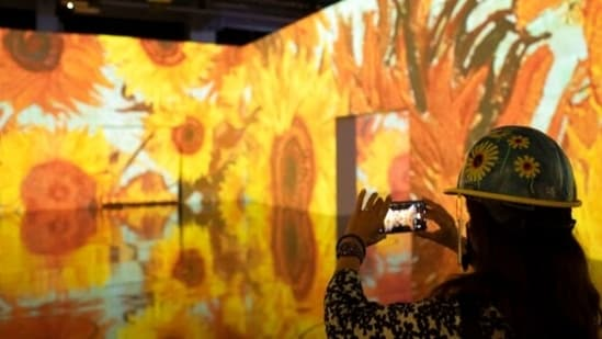 Members of the media tour the Immersive Van Gogh show, Wednesday, May 26, 2021 at Pier 36 in New York. The exhibit celebrates the work of the 19th century Dutch impressionist painter and opens for preview on June 4. (AP)