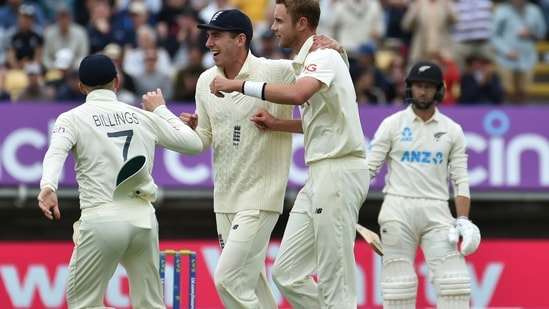 England's Stuart Broad, second right, celebrates with teammates the dismissal of New Zealand's Devon Conway.(AP)