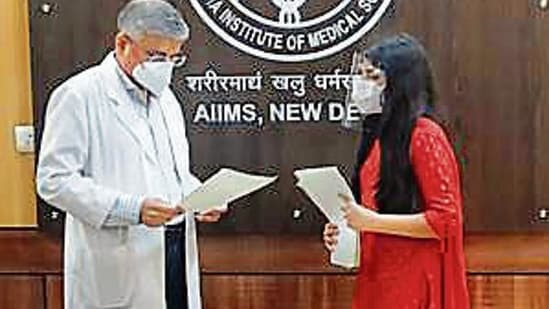Students handed over the cards to AIIMS director Dr Randeep Guleria (Image courtesy: Sourced)