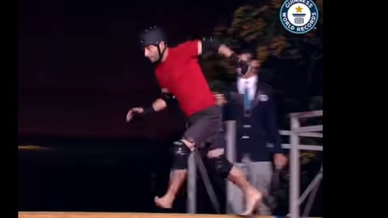 Guinness World Records' Facebook video on people competing to create the record for crossing a greased pole in the fastest time.(Facebook/@GuinnessWorldRecords)