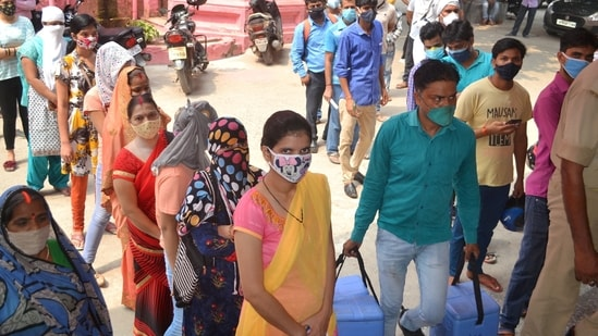 Varanasi: People wait to receive a dose of the Covid-19 vaccine at a vaccination centre in Varanasi, on Friday, June 11, 2021.