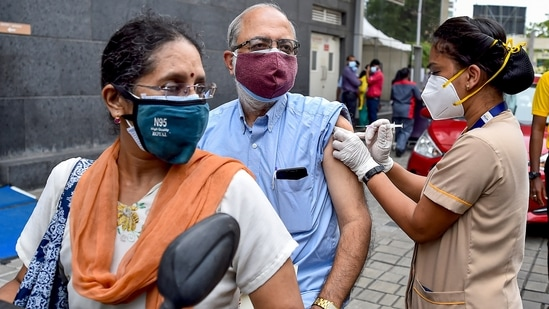 Chennai: A health worker administers a dose of the COVID-19 vaccine to a person at a drive-in vaccination centre, at MGM Hospital, in Chennai, Friday, June 11, 2021. (PTI)