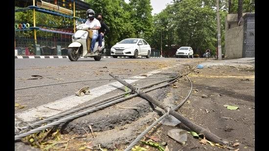 Damaged electrical wires near Ludhiana Club Road following heavy rain and gusty winds on Thursday night (Gurpreet Singh/HT)