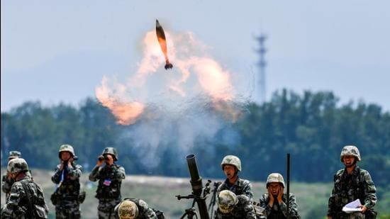 Soldiers of Chinese People's Liberation Army fire a mortar during a live-fire exercise in Anhui province, China. (REUTERS)