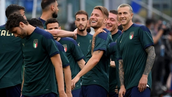 Italy's Ciro Immobile and Federico Bernardeschi with teammates during training.(Reuters)