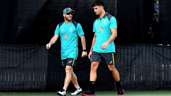 David Warner (L) and Marcus Stoinis. (Getty Images)