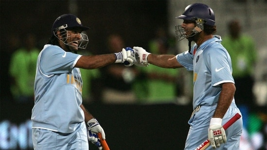 MS Dhoni and Yuvraj Singh bump fists after the latter smashes 6 sixes off Stuart Broad. (Getty Images)