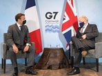 UK Prime Minister Boris Johnson and French President Emmanuel Macron attend a bilateral meeting during G7 summit in Cornwall.(Reuters)