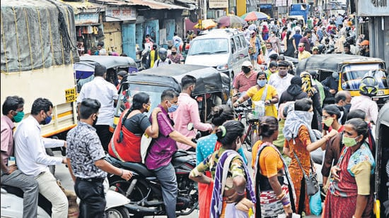 """Crowd seen at a market in Raviwar peth. Medical experts say rampant reopening of public spaces could invite a severe """"possible"""" third wave of Covid-19 and caution needs to be taken while stepping out in public places. (Rahul Raut/HT PHOTO)"""