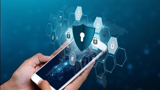 Unlocked smartphone lock Internet phone hand Business people press the phone to communicate in the Internet. Cyber security concept hand protection network with lock icon and virtual screens Space put message Blue tone (Getty Images/iStockphoto)