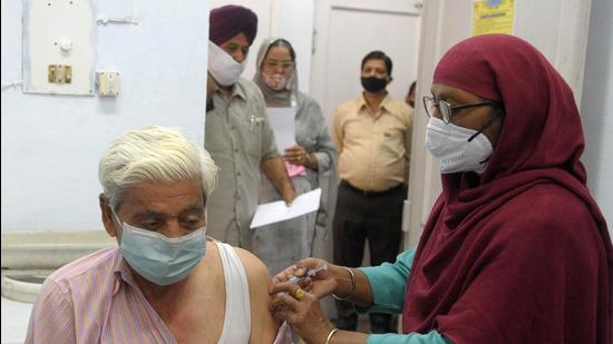 File photo: A resident gets the Covid-19 vaccine shot. (Ravi Kumar/ Hindustan Times)