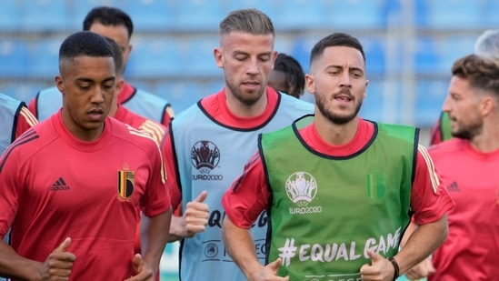 Belgium's Youri Tielemans, Toby Alderweireld and Eden Hazard, from left, warm up with teammates during a training session of the national team at Petrovsky stadium in St. Petersburg, Russia.(AP)