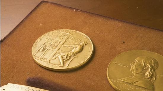 This undated photo shows the front and back sides of the medal awarded for the Pulitzer Prizes in New York. (AP)