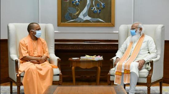 Uttar Pradesh Chief Minister Yogi Adityanath meets Prime Minister Narendra Modi at his official residence, in New Delhi on Friday. (Twitter/@CMOfficeUP)