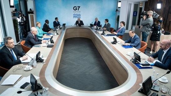 A general view of G7 leaders and their guests at a working session during the G7 summit in Carbis Bay, Cornwall, UK.(AFP)