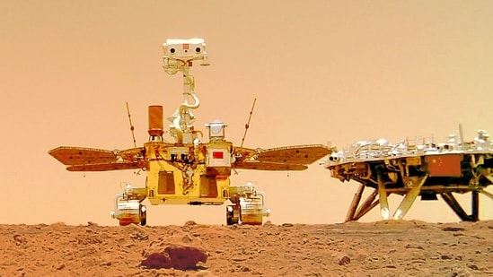 """China's Zhurong rover with its landing platform in a """"selfie"""" from the surface of the Red Planet. (Photo via China National Space Administration (CNSA))"""