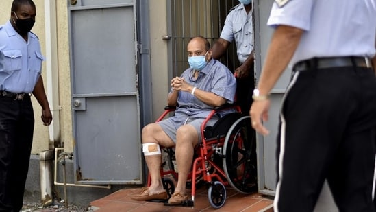 Mehul Choksi exits in a wheelchair the magistrate's court in Roseau, Dominica, Friday, June 4. (AP)(HT_PRINT)