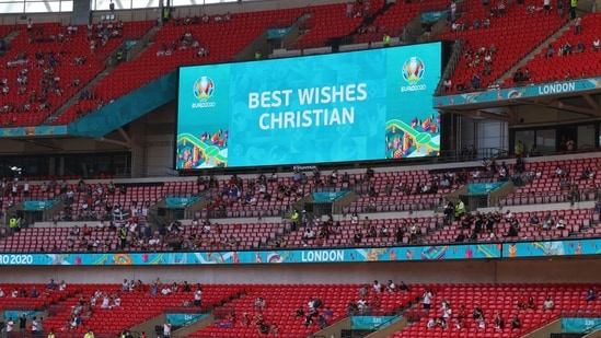 General view of the big screen with a message for Denmark's Christian Eriksen.(Pool via REUTERS)