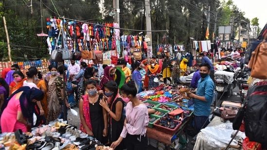 A rush of people shopping in a weekly market at Kingsway Camp, in New Delhi.