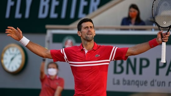 Novak Djokovic reacts after winning a point against Stefanos Tsitsipas of Greece during their final match of the French Open.(AP)