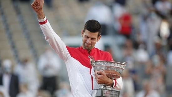 Serbia's Novak Djokovic celebrates with the trophy after winning the French Open against Greece's Stefanos Tsitsipas(REUTERS)