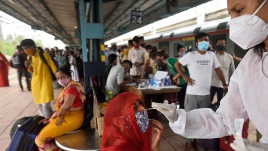 In picture - A BMC health worker collecting samples for Covid-19 test at Dadar Station in Mumbai.(HT Photo)