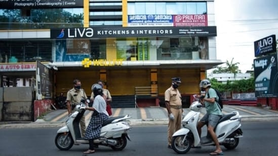 """""""Depending on the Covid-19 situation, restrictions will be imposed region-wise. It will be implemented by local bodies,"""" Kerala chief minister Pinarayi Vijayan said. In picture - Policemen on duty during lockdown in Kochi, Kerala.(AP)"""