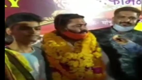 BJP Yuva Morcha district president Mridul Dwivedi along with his guests were seen without masks in public and was not following the social distancing norms.(ANI Photo)