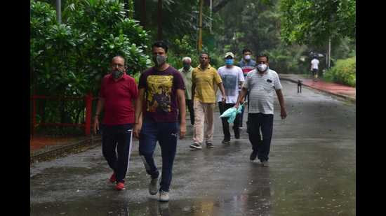 Locals busy taking their morning walk at the Chandra Shekhar Azad Park on Monday. (HT PHOTO)