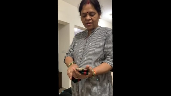 Chabi Gupta's mom inspects her Gucci belt (Instagram/@yourregularmom)