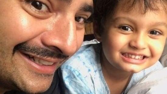 Karan Mehra poses with son Kavish. He has been accused of domestic violence by wife Nisha Rawal.