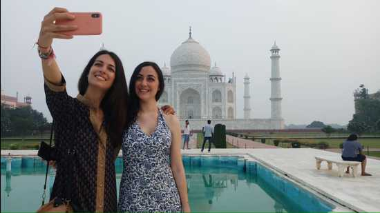 File photo of tourists taking a selfie at the Taj Mahal on September 21 last.