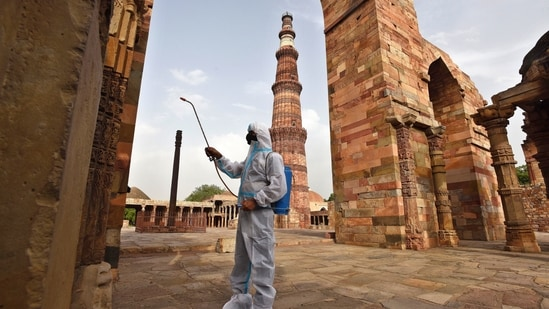 A worker chemically disinfects the premises at Qutub Minar complex, as the ASI Monuments are to reopen from tomorrow, in New Delhi, India, on Tuesday, June 15, 2021. (Photo by Raj K Raj / Hindustan Times)