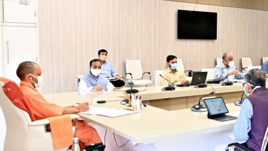 Uttar Pradesh chief minister Yogi Adityanath at a meeting in Lucknow on Monday.(HT Photo)
