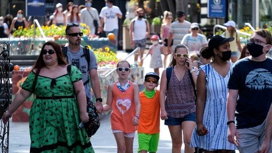 People arrive at Universal Studios in Universal City, California, Tuesday, June 15, 2021.(AP)