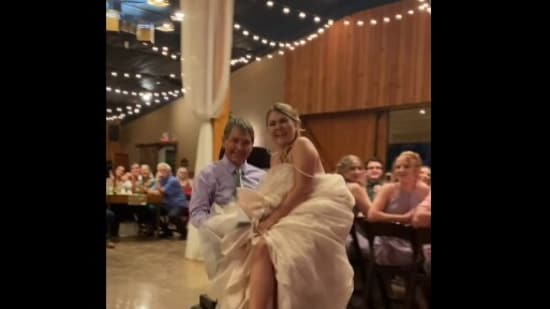 The image shows the bride Tenaya Snider and her father dancing.(Facebook/@Dakota Snider)