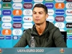 Cristiano Ronaldo removed two Coca-Cola bottles as he said 'Agua' (Portuguese for water), urging people to drink water instead, at his press conference on Monday.(Reuters Photo.)