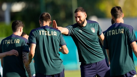 Italy goalkeeper Gianluigi Donnarumma with teammates during a training session(AP)