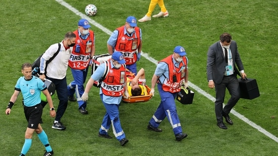 Russia's Mario Fernandes is stretchered off after sustaining an injury(Pool via REUTERS)