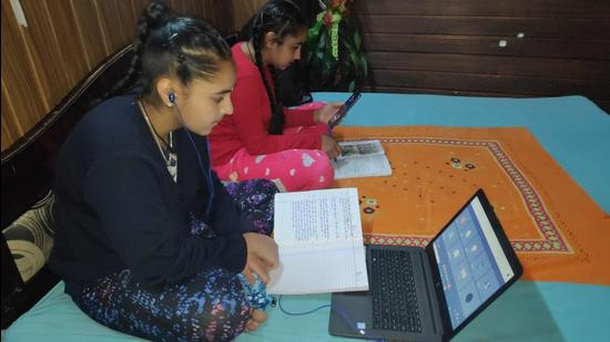 Schoolchildren attending online classes at home during the Covid-induced lockdown in Shimla. (HT Photo)