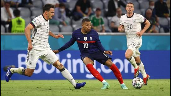 France's Kylian Mbappe in action with Germany's Mats Hummels during the Group F match of Euro 2020 in Munich on Tuesday. (Reuters)