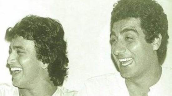 Mithun Chakraborty and Raj Babbar share a light moment in this throwback picture.