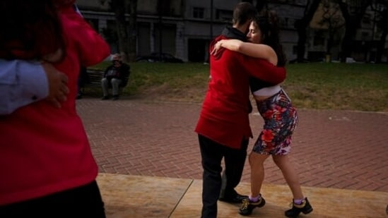 In this June 6, 2021 file photo, a couple dances tango at a park amid the Covid-19 pandemic lockdown in Buenos Aires, Argentina. Nostalgia for dance makes many tango dancers, or tangueros, defy restrictions with clandestine milongas in closed places or public spaces.(AP)