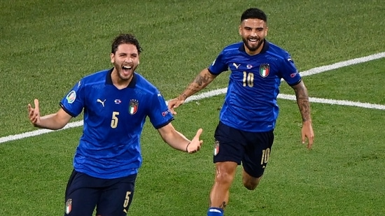 Italy's Manuel Locatelli celebrates with his teammate Lorenzo Insigne after scoring his side's first goal during the Euro 2020 soccer championship group A match between Italy and Switzerland at the Rome Olympic stadium.
