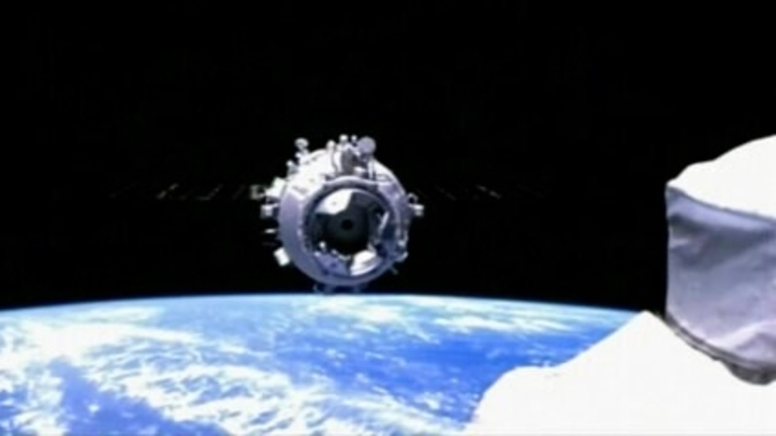 Chinese crewed spaceship Shenzhou-12 docks with new space station module Tianhe