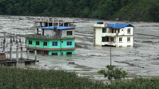 Houses submerged in floodwaters in Sindhupalchok, some 70 km northeast of Nepal's capital Kathmandu on June 16. As many as 20 people including three Indians have gone missing after floods triggered by heavy rains struck Sindhupalchok district in central Nepal, a government official told ANI.(Prakash Mathema / AFP)